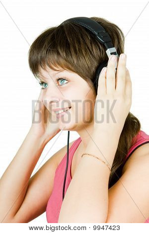 Beautiful Girl In Headphones Listens To Music