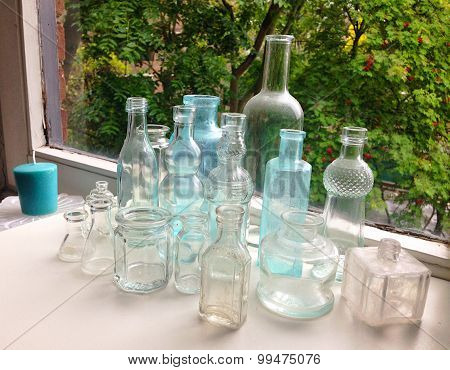 Antique Decorative Medicine Bottles On Window Sill