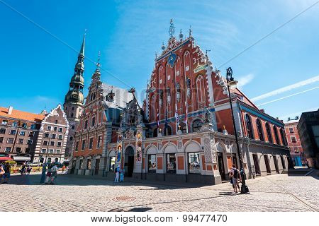 Riga, Latvia- August 20, 2015: Day View Of The Town Hall Square And The Blackheads House. The Buildi