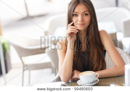 Morning coffee in the cafe for summer beautiful woman