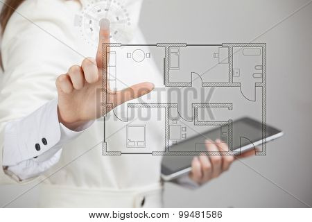 Young woman architect working with a virtual apartment plan