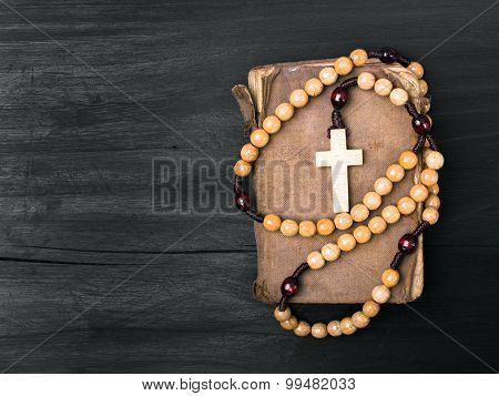 rosary and prayer book
