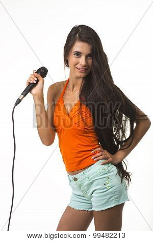 The woman in orange shirt with microphone.