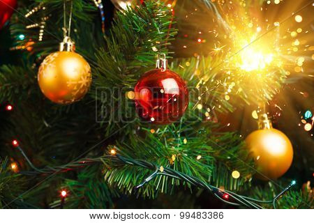 Christmas tree decoration with shiny sparkler
