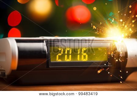 Led display of digital clock with 2016 new year with sparkler