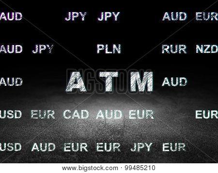 Money concept: ATM in grunge dark room