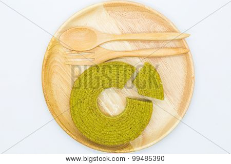 Soft layers green tea cake on wooden plate