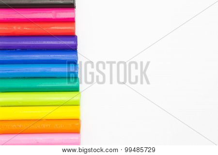 Clay stickes with rainbow colours for children playing