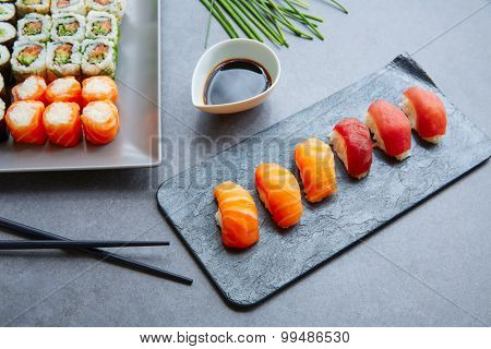 Sushi Maki and Niguiri with soy sauce and California roll
