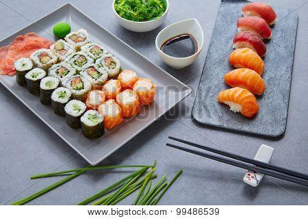 Sushi Maki and Niguiri California roll with seaweed chuka salad soy sauce and wasabi