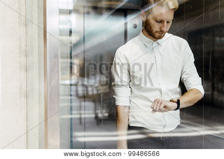 Businessman Checking Watch While Standing In Elevator