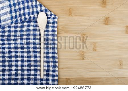 tablecloth and wooden spoon