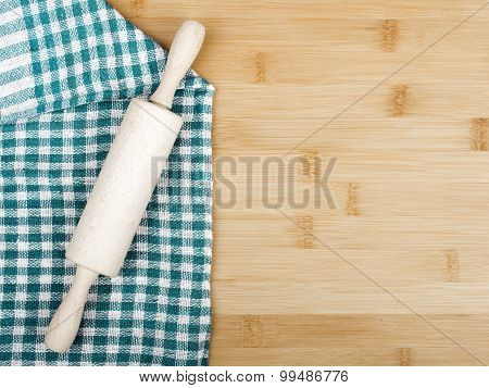 table covered with tablecloth and rolling pin