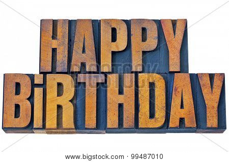 happy birthday greetings - isolated words in vintage letterpress wood type printing blocks stained by color inks