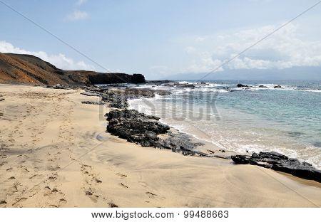 Rock Chain On White Sand Beach