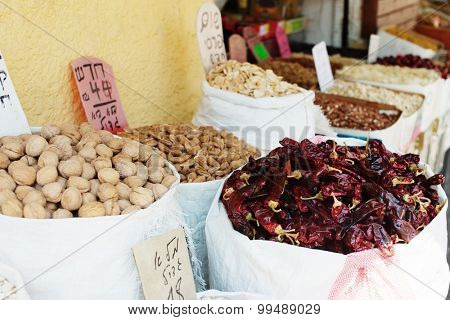 Spices, nuts and vegetables in open market Tel Aviv in Israel