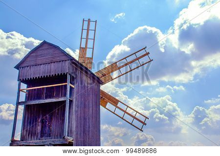 Ukrainian Wooden Windmill Windmill Against The Sky With Clouds