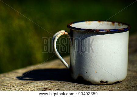 Old enameled mug