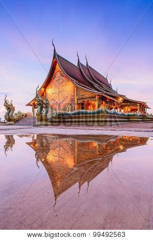 Photo Of Reflection Of Wat Pa Sirinthon Wararam,ubonrachatanee,thailand After Raining Before  The Su