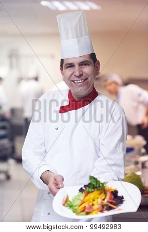 chef in hotel kitchen preparing and decorating food, delicious vegetables and meat  meal dinner
