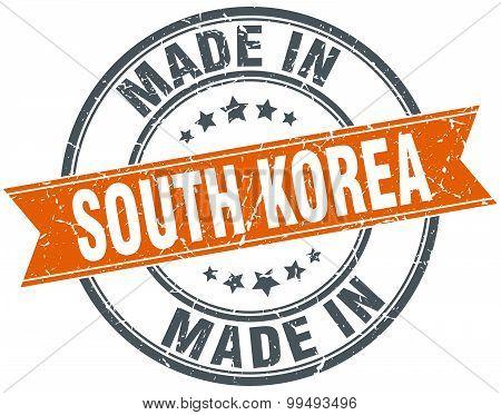 South Korea Orange Grunge Ribbon Stamp On White