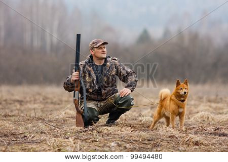 Hunter With A Gun And A Dog