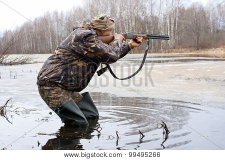 Hunter Shooting From A Gun