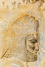 pic of tribute  - Armenian tribute head profile relief detail on the stairway facade of the Apadana at the old city Persepolis - JPG