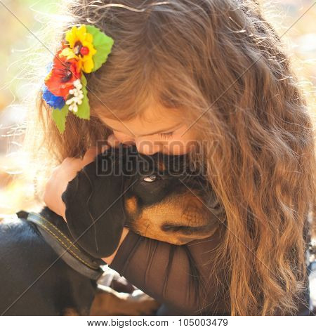 Little Kid Kissing And Hugging Puppy.