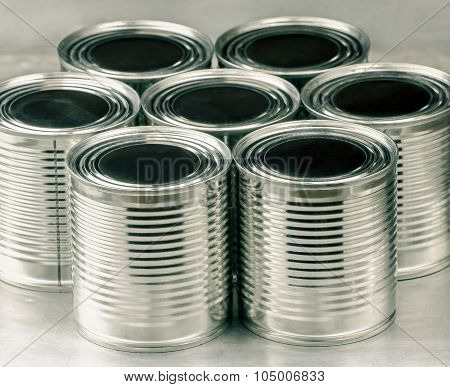 Tin cans for food on aluminum background
