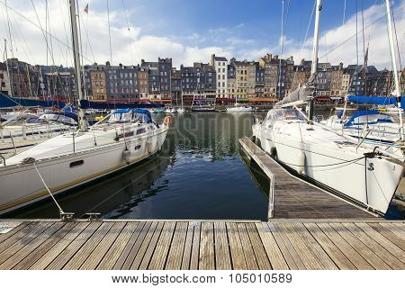 HONFLEUR FRANCE - OCTOBER 12: The old port of Honfleur famous for having been painted many times by artists on October 12 2015 in Honfleur France
