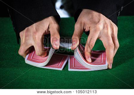 Closeup Of Hands Shuffling Cards Casino