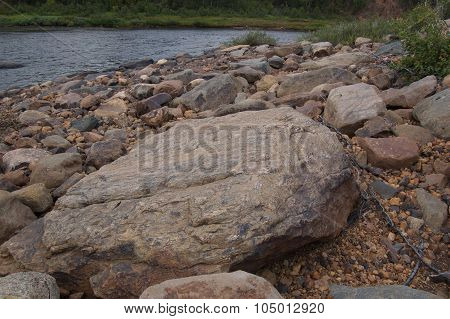 Beautiful stone river coast behind a polar circle.