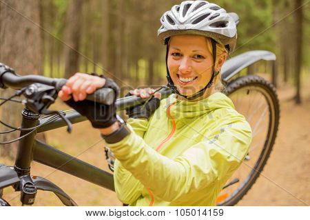 Woman carrying bicycle