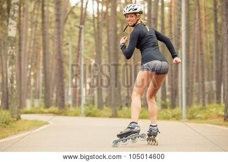 Athletic woman skating and smiling