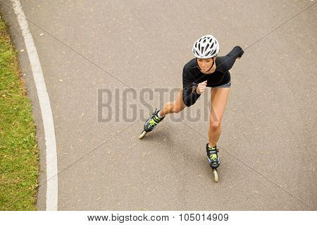 Athletic roller skater exercising