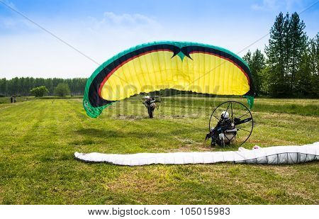 Man With Motorized Paraglider Takes Off From A Field