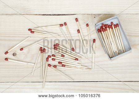 Matchstick And Matchbox On Wooden Background