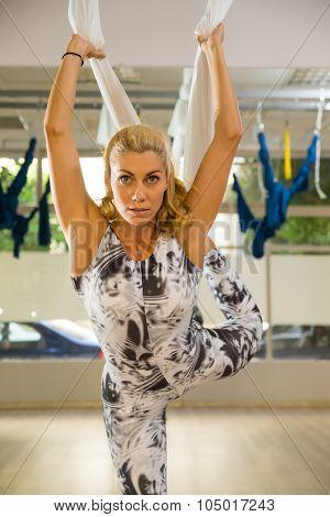 Woman doing anti gravity Aerial yoga exercise