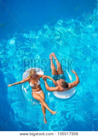 Young couple having fun at the swimming pool