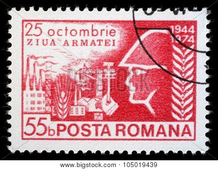 ROMANIA - CIRCA 1974: a stamp printed in Romania shows Army Day, soldier before industrial complex, circa 1974.
