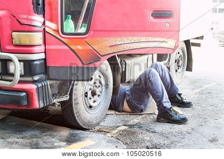 Mechanic Under Truck Reparing Dirty Greasy Oily Engine With Problem