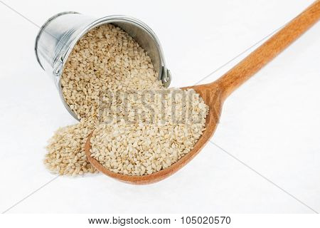 Bucket Of Sesame Crumbles In The A Wooden Spoon
