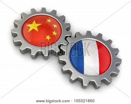 Chinese and French flags on a gears (clipping path included)
