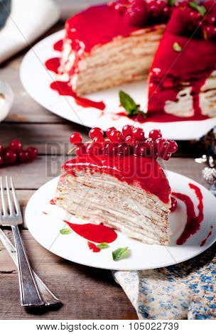 Traditional crepe cake with custard and berry