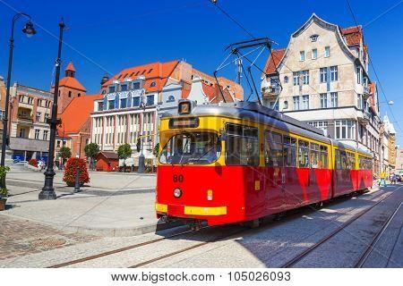 GRUDZIADZ, POLAND - AUGUST 10, 2015: Old tram on the street of Grudziadz, Poland. Grudziadz is a historic city located at Vistula river in northern Poland.
