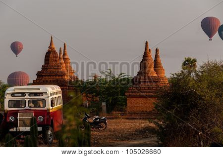 Bus Pagoda Stupa and hot air balloon over Bagan
