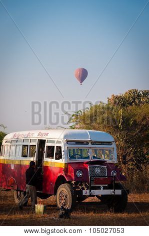 Bus and hot air balloon in Bagan