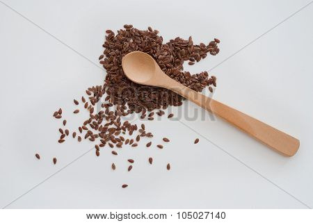 Isolated Flaxseed And Wooden Spoon On White Background - Studio Shot