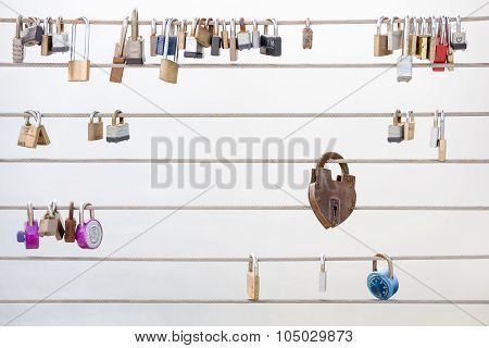 Love Locks Hanging From A Cable Railing